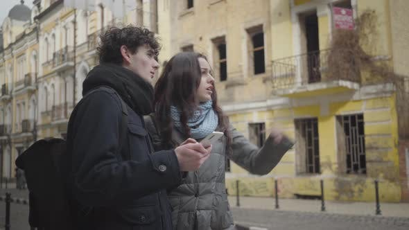 Thumbnail for Young Caucasian Couple Discussing the Route and Leaving. Boyfriend and Girlfriend Using Online Map