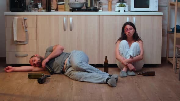 Alcoholic Man Lying on the Floor