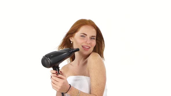 Thumbnail for Young Redhead Girl Singing While Blow-dry, Close Up, Slow Motion, Bathroom