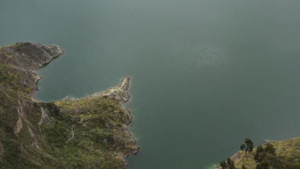 Thumbnail for Aerial view flying over the last bit of land decending over the water surface