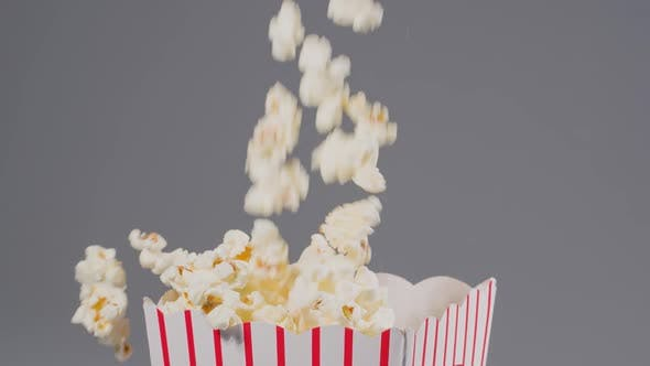 Thumbnail for Popcorn falling in slow motion into a popcorn bucket