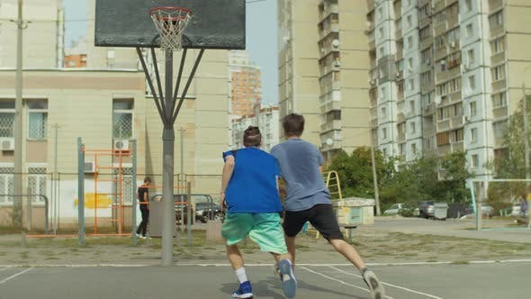Thumbnail for Teenage Streetball Players Playing One on One Game