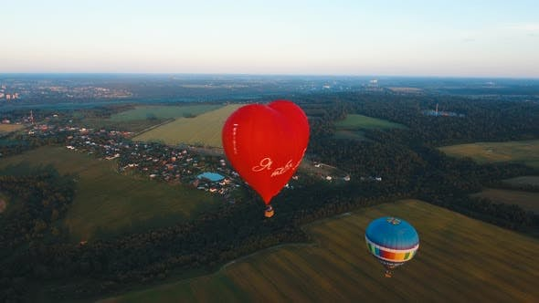 Thumbnail for Hot Air Balloon in the Sky Over a Field.
