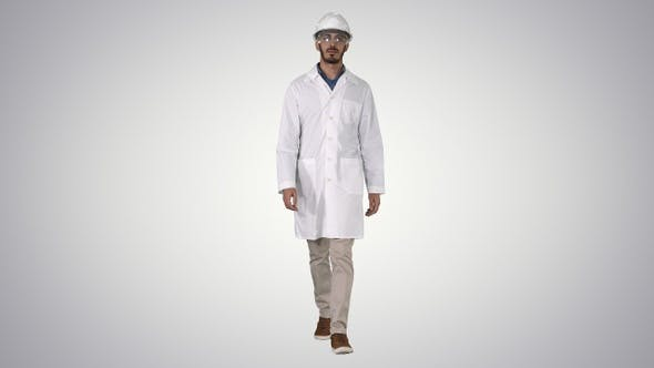 Thumbnail for Science engineer walking in safety helmet and glasses on