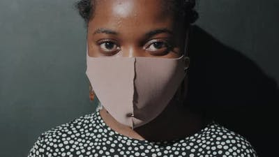 Portrait of Afro Woman in Face Mask in Studio