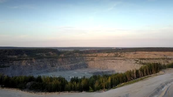 Thumbnail for Huge Grey Mining Quarry Against Small Town Silhouette