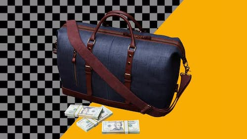 Spinning a bag with bundles of money around the bag.