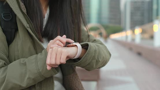 Thumbnail for Woman using smart watch in the city