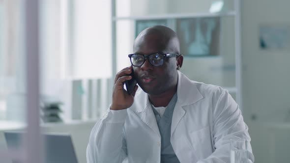 Thumbnail for African American Doctor Talking On Phone