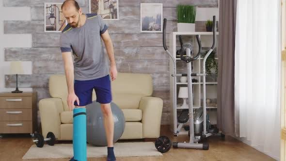 Man Unrolled Yoga Mat