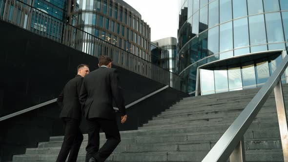 Thumbnail for Two Businessmen Climb the Stairs