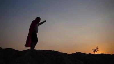 superhero boy running on the field