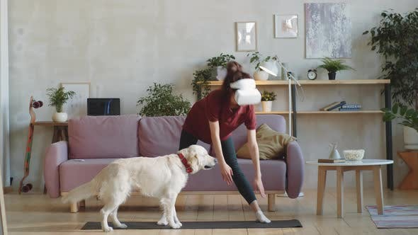 Woman in VR Headset Exercising in Living Room