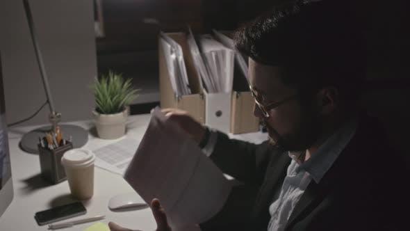 Thumbnail for Man Finishing Financial Report at Night
