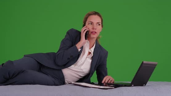 Thumbnail for Successful woman in business suit making phone call on green screen