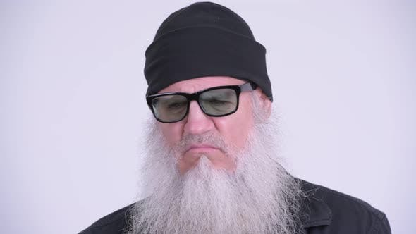 Thumbnail for Mature Bearded Hipster Man Looking Serious While Thinking