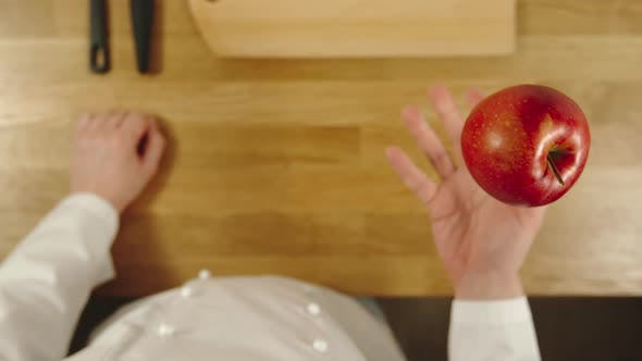 Thumbnail for Cook Throws Up Red Apple And Catches It