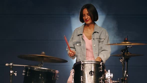 Thumbnail for Young Stylish Woman Is Playing Drums in Professional Music Studio
