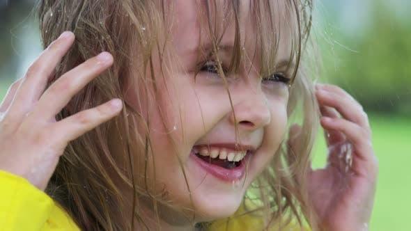 Thumbnail for Girl Laughing in Rain