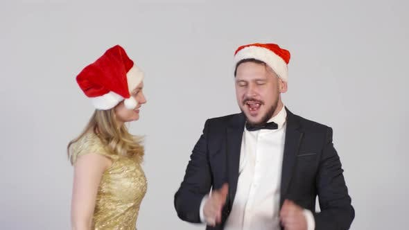 Thumbnail for Happy Man and Woman Dancing at Christmas Party