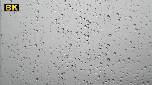 Transparent Rain Drops on Wet Window Glass Surface