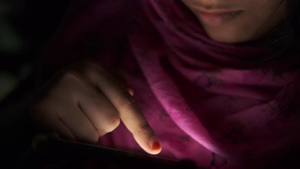 Asian Women Hand Holding Smart Phone at Night