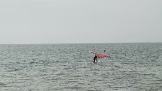 Man Riding On An Air Foil Wing On The Ocean 4k 60p