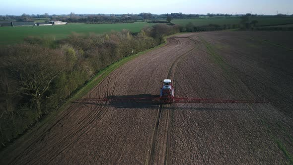 Farmer Spraying Fields on an Arable Farm with Glyphosate Herbicide