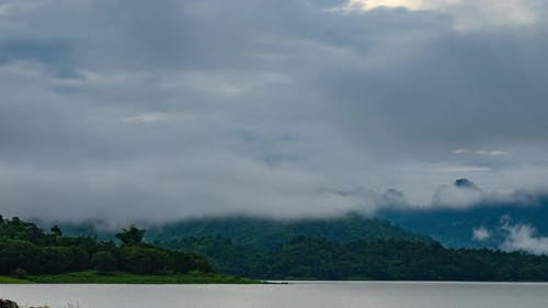 time-lapse of tropical mountain landscape view with lake and cloud, Asian natural scene, Thailand