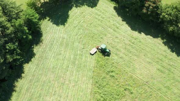 Thumbnail for Green Tractor Hay Cutter Trees Aerial View