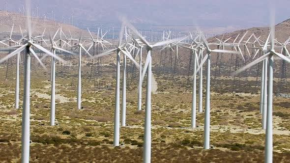 Thumbnail for Aerial shot of energy producing wind turbines