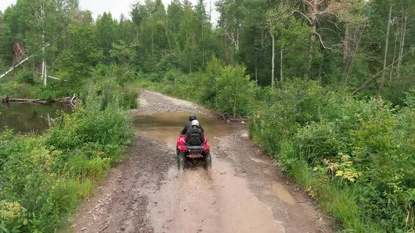 Thumbnail for Aerial of People Driving ATV in Rough Terrain