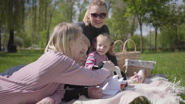 Thumbnail for Portrait Family Outdoor Recreation Two Young Mothers and Their Children at a Picnic