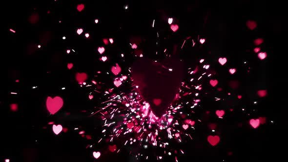 Thumbnail for Pink heart confetti and sparks flying against heart