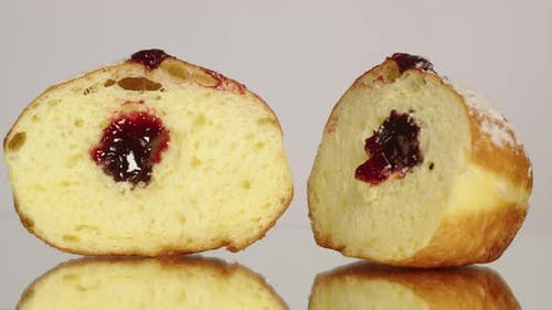 Donut With Jam Sprinkled With Powdered Sugar