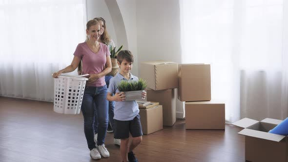 Young Family Unpacking Things in New House