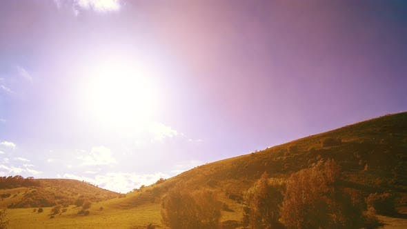 Thumbnail for UHD Mountain Meadow Timelapse at the Summer. Clouds, Trees, Green Grass and Sun Rays Movement