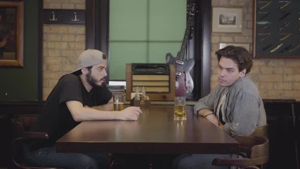 Cover Image for Two Men Sitting in the Bar Drinking Beer Together