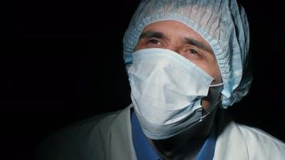 Physician Praying at the Dark Room