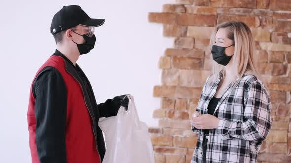 Thumbnail for Delivery Man in a Protective Mask Is Giving an Order To a Woman