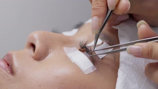 Thumbnail for Woman having eye lash extension process