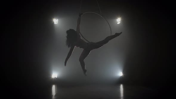 Thumbnail for Aerial Acrobat in the Ring. A Young Girl Performs the Acrobatic Elements in the Air Ring