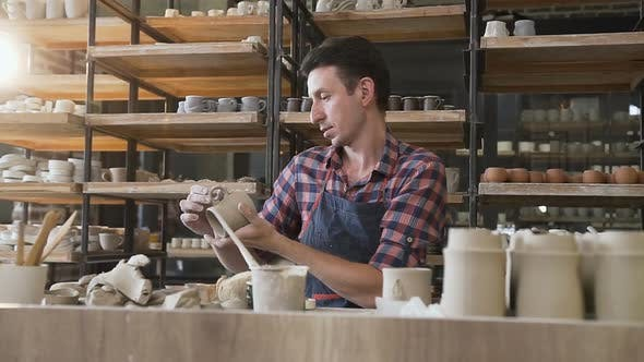 Thumbnail for Caucasian Male Potter Making Ceramic Cap in the Pottery