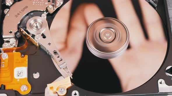 Thumbnail for Hard Disk Drive Inside. Reflection of Palms on Mirror Surface of a Magnetic Disk