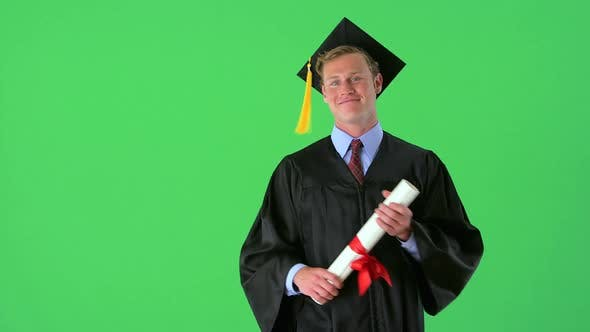 Thumbnail for Young happy graduate on greenscreen
