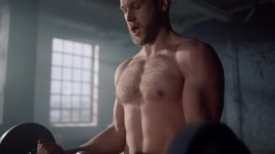 Shirtless Man Doing Arm Exercises