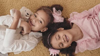 Girls Lying on Floor Smiling