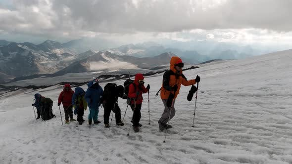 Concept of extreme sport and hobbies, climbers on the background of mountain range