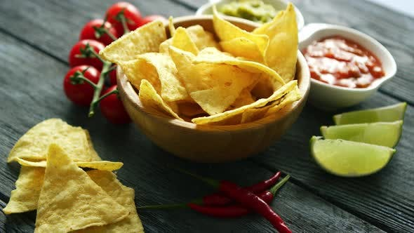 Thumbnail for Delicious Nachos and Sauces on Table