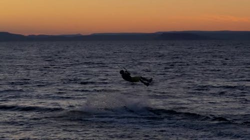 Kitesurfing Against a Beautiful Sunset